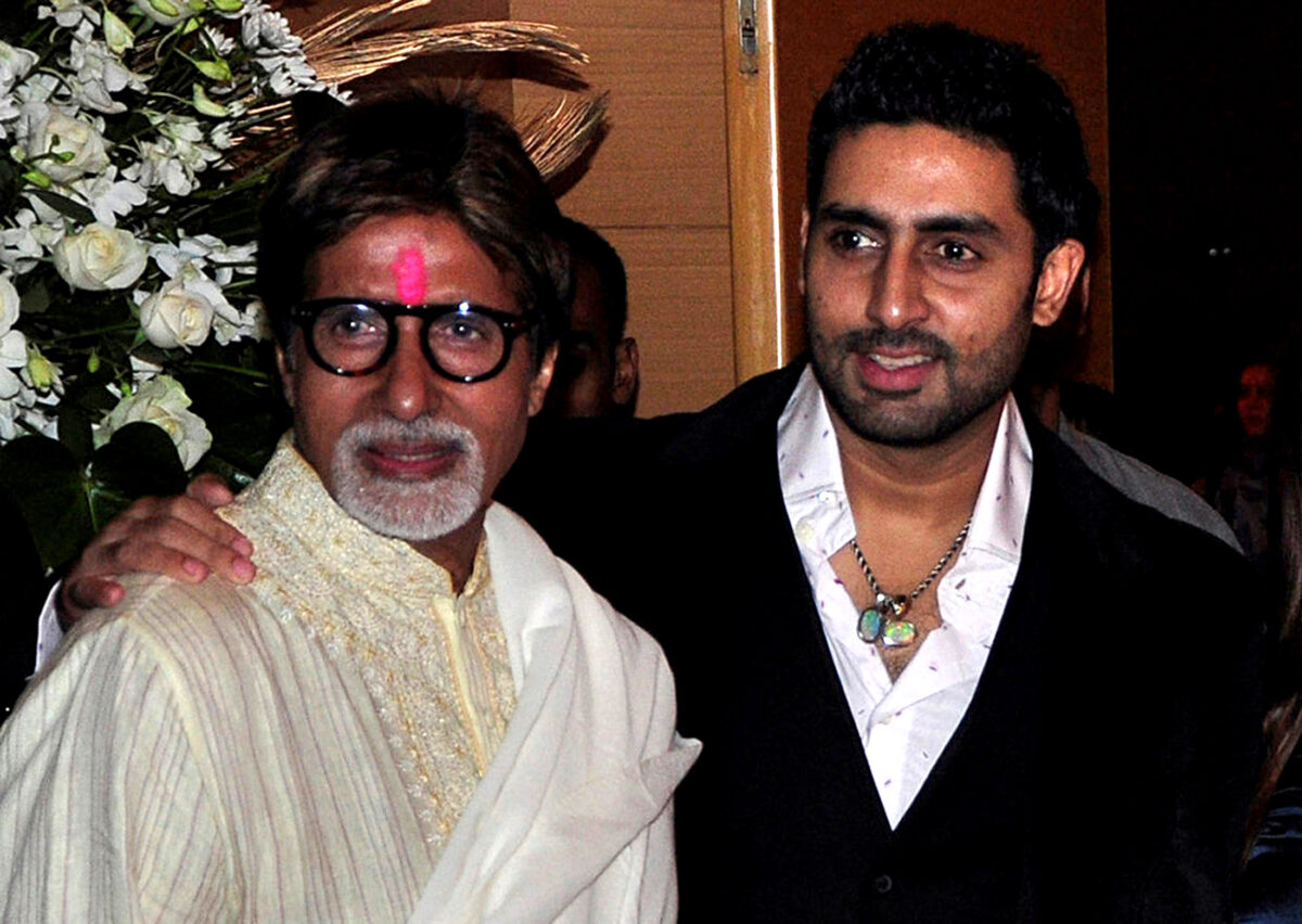 Bollywood actors Amitabh Bachchan (L) and his son Abhishek Bachchan