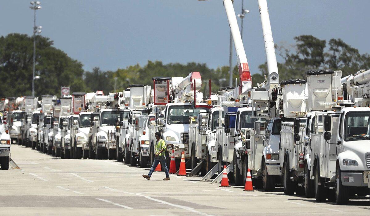 Dozens of utility trucks