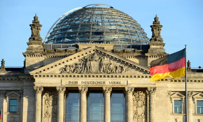 The German national flag is seen in front of the Reichstag building housing the German parliament Bundestag on Dec. 16, 2013. (John Macdougall/AFP via Getty Images)