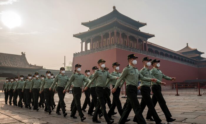 People's Liberation Army soldiers march next to the entrance to the Forbidden City on May 21, 2020, the day before the beginning of the two-week National People's Congress. (Nicolas Asfouri/AFP via Getty Images)