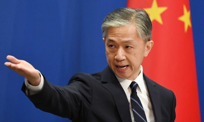 Chinese Foreign Ministry spokesman Wang Wenbin takes a question during a daily Foreign Ministry briefing in Beijing on July 24, 2020. (Greg Baker/AFP via Getty Images)