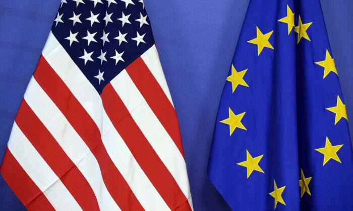 The U.S. national flag (L) and the European Union flag are seen side-by-side during a meeting at the EU Commission headquarter in Brussels on July 13, 2015. (Thierry Charlier/AFP via Getty Images)