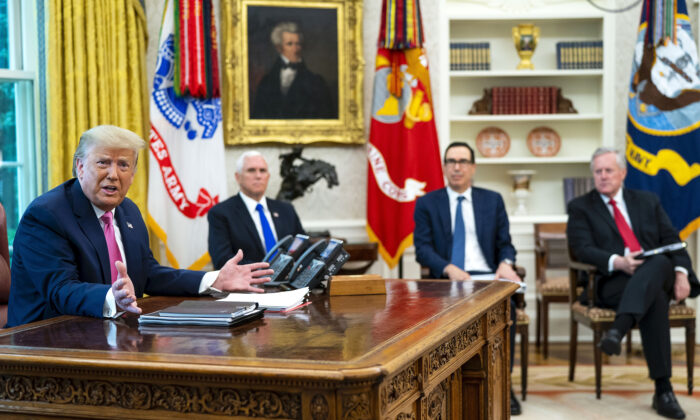 President Donald Trump talks to reporters while hosting (2nd L–R) Vice President Mike Pence, Treasury Secretary Steven Mnuchin, White House chief of staff Mark Meadows, and Republican congressional leaders in the Oval Office at the White House on July 20, 2020. (Doug Mills-Pool/Getty Images)