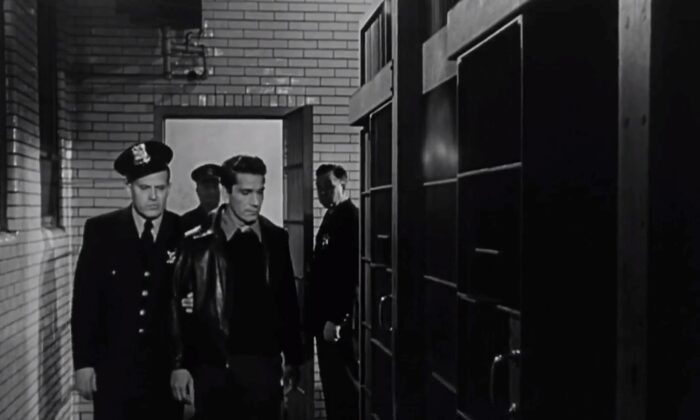 """Based on a true story, """"Call Northside 777"""" tells how Frank Wiecek (Richard Conte, in front, R), here escorted by an officer to his cell, is found innocent of murder. (Twentieth Century Fox)"""