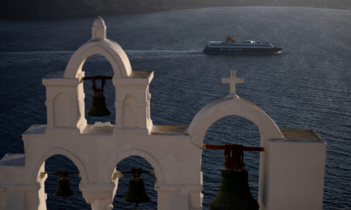 A ferry sails near the island of Santorini, Greece, on May 6, 2020. (Alkis Konstantinidis /Reuters)