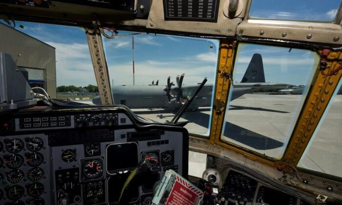 The first of 17 new CC-130J Hercules aircraft is seen through the cockpit of an older model of the Hercules after landing at Canadian Forces Base (CFB) Trenton on June 4, 2010. (The Canadian Press/Adrien Veczan)