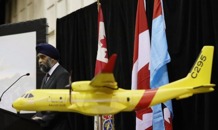 Defence Minister Harjit Sajjan announces that the federal government of Canada will spend $2.3 billion to replace the military's ancient search-and-rescue planes with 16 new aircraft from European aerospace giant Airbus at CFB Trenton in Trenton, on Dec. 8, 2016. (The Canadian Press/Lars Hagberg)