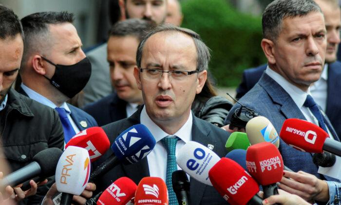 Kosovo Prime Minister Avdullah Hoti talks to media outside the parliament building in Pristina, Kosovo, on June 3, 2020. (Laura Hasani/Reuters)