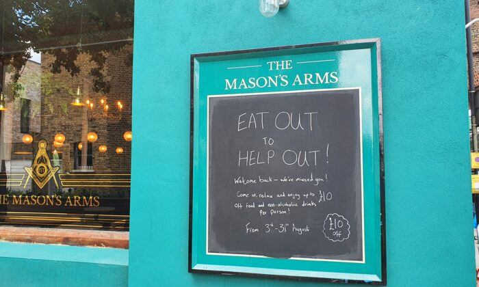 A sign advertising up to 10 pounds off for food and non-alcohol drinks outside a pub, in London, Britain, on Aug. 3, 2020. (Lily Zhou/The Epoch Times)