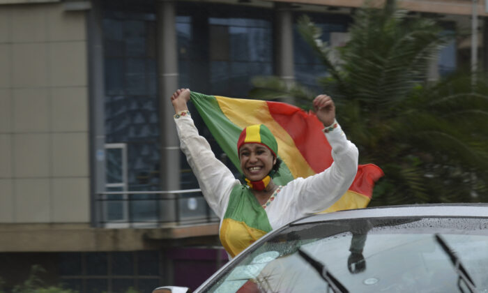 A woman reacts to the progress made on the Nile dam, during celebrations, in Addis Ababa, Ethiopia, on Aug. 2, 2020.   (AP Photo/Samuel Habtab)