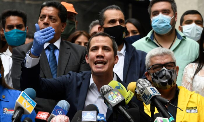 Venezuelan opposition leader and self-proclaimed acting president Juan Guaido delivers a press conference at the headquarters of the Accion Democratica (Democratic Action) party in Caracas on June 17, 2020. (Federico Parra/AFP via Getty Images)