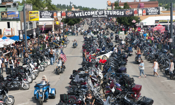 Bikers ride down Main Street on the first day of the annual Sturgis Motorcycle Rally Aug. 3, 2015 in Sturgis, South Dakota. (Andrew Cullen/Getty Images)