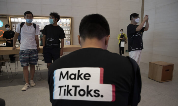 A man wears a shirt promoting TikTok at an Apple store in Beijing, China, on July 17, 2020. (Ng Han Guan/AP Photo)