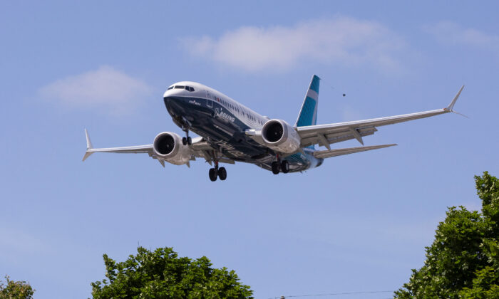 A Boeing 737 MAX airplane lands after a test flight at Boeing Field in Seattle, Wash., on June 29, 2020.  (Karen Ducey/File Photo/Reuters)