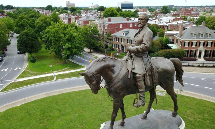 The statue of Confederate General Robert E. Lee that stands in the middle of a traffic circle on Monument Avenue in Richmond, Va., on June 27, 2017. (Steve Helber/AP Photo)
