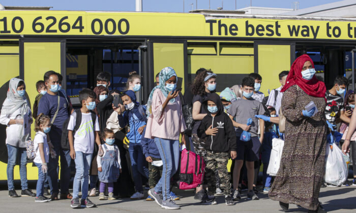 A group of 85 asylum seekers, including families with children with serious health problems, departs from Greece for Germany on July 24, 2020. (Milos Bicanski/Getty Images)