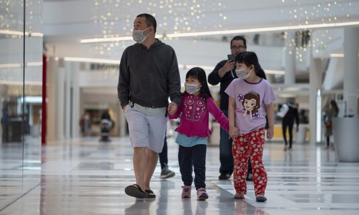 People wear masks as they walk through the Mall of America in Minneapolis, Minnesota, on June 10, 2020. (Stephen Maturen/Getty Images)
