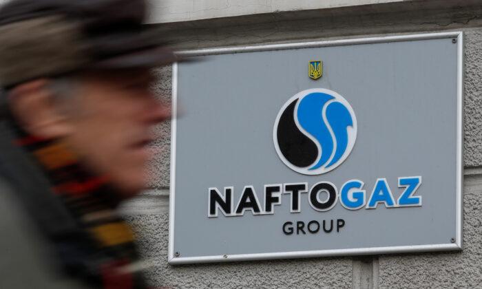 A man walks past the headquarters of the Ukrainian state energy company Naftogaz in central Kiev, Ukraine, on Dec. 2, 2019. (Valentyn Ogirenko/File Photo/Reuters)
