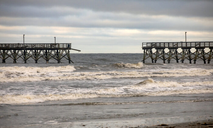The private Sea Cabins pier is seen damaged following Hurricane Isaias, in North Myrtle Beach, S.C., on Aug. 4, 2020. (Jason Lee/The Sun News via AP)