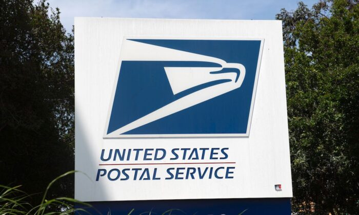 The USPS logo is seen in front of the Los Angeles Plant in Los Angeles, Calif., on April 29, 2020. (Valerie Macon/AFP via Getty Images)