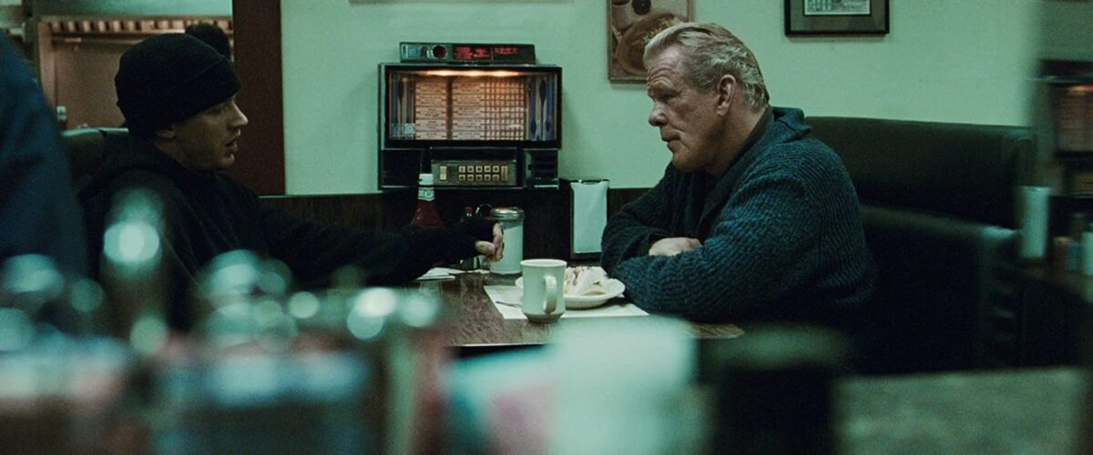 """two men at diner table in """"Warrior"""""""