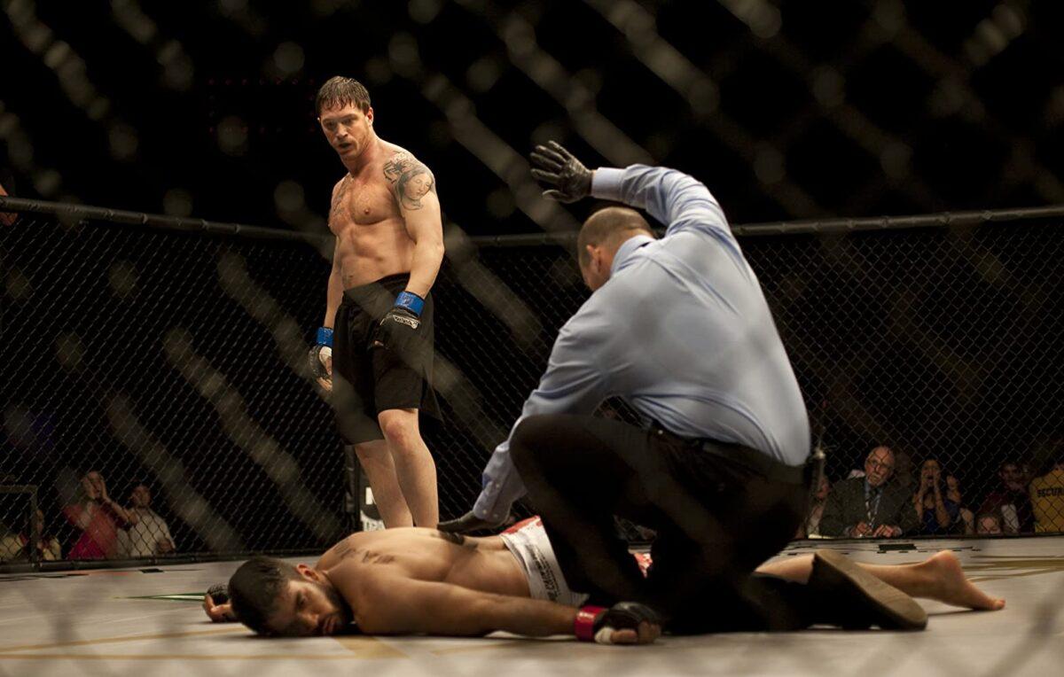 "three men in cage-fighting octagon in ""Warrior"""