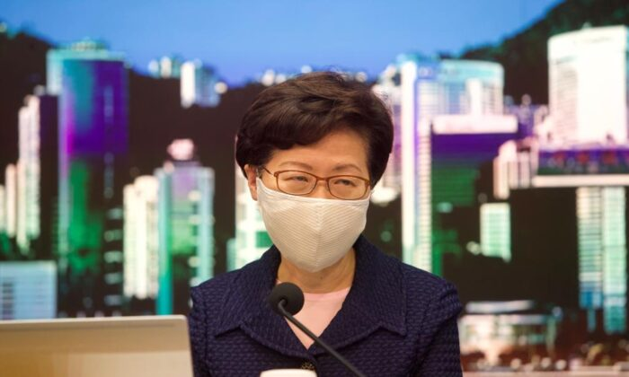 Hong Kong leader Carrie Lam announces the postponement of the city's legislative council election in a press conference on July 31, 2020. (Yu Gang/The Epoch Times)