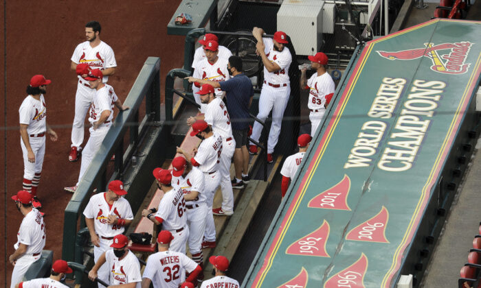 Members of the St. Louis Cardinals wait to be introduced before the start of a baseball game against the Pittsburgh Pirates in St. Louis, Detroit, Michigan, on July 24, 2020. (AP Photo/Jeff Roberson)