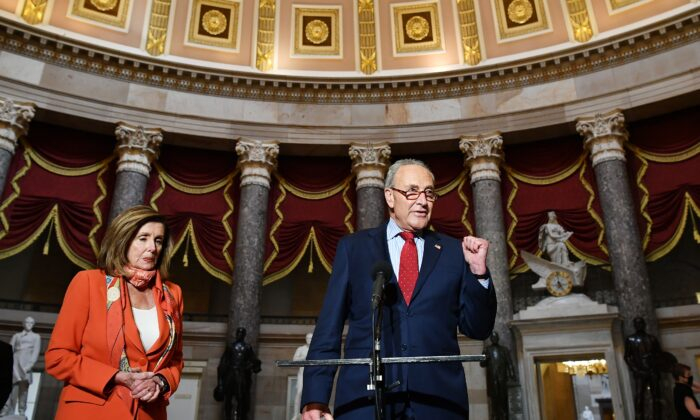 Senate Minority Leader Sen. Chuck Schumer (D-N.Y.) speaks to reporters as House Speaker Nancy Pelosi (D-Calif.) listens, at the U.S. Capitol in Washington on Aug. 4, 2020. (Mandel Ngan/AFP via Getty Images)