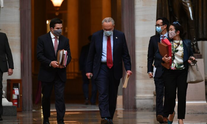 Senate Minority Leader Chuck Schumer (D-N.Y.) heads to a meeting on the CCP virus relief bill at the U.S. Capitol in Washington on Aug. 4, 2020. (Mandel Ngan/AFP via Getty Images)