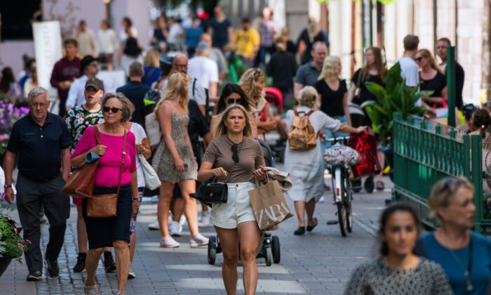 People walk in Stockholm during the novel coronavirus (COVID-19) pandemic on July 27, 2020. (Jonathan Nackstrand/AFP via Getty Images)