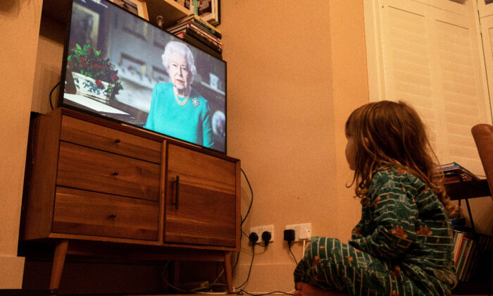In this file photo, Isaac (4) watches Queen Elizabeth II during a televised address to the nation in London, Britain, on April 5, 2020. (Reuters/Simon Dawson/File Photo)