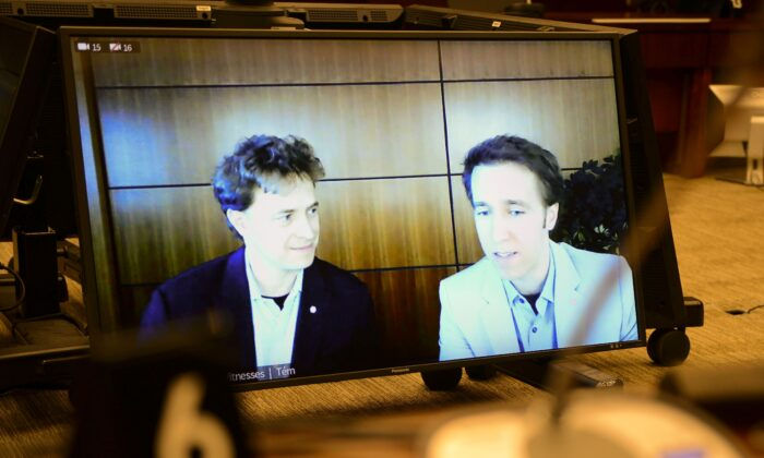 Marc Kielburger (L) and his brother Craig appear as witnesses via videoconference during a House of Commons finance committee hearing in the Wellington Building in Ottawa on July 28, 2020. (The Canadian Press/Sean Kilpatrick)