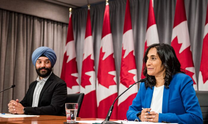 Navdeep Bains, Minister of Innovation, Science and Industry and Anita Anand, Minister of Public Services and Procurement make an announcement regarding vaccine procurement, in Toronto, on Wed., Aug., 5, 2020. (THE CANADIAN PRESS/Christopher Katsarov)