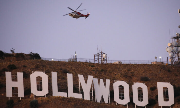 A firefighting helicopter flies near the Hollywood sign as the Barham fire burns nearby in Los Angeles, Calif., on Nov. 09, 2019. (Mario Tama/Getty Images)
