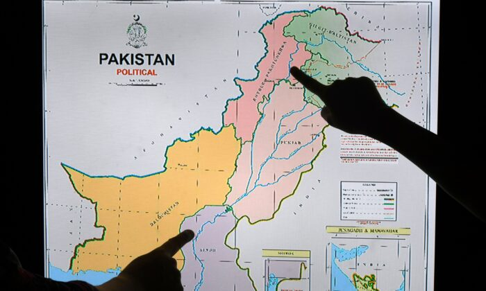 Journalists look at Pakistan's new political map on a screen at the Daily Metro Watch newspaper offices in Islamabad on Aug. 4, 2020. (AAMIR QURESHI/AFP via Getty Images)