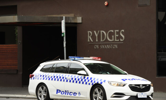 A police car sits outside the Rydges on Swanston hotel on July 14, 2020 in Melbourne, Australia. (Quinn Rooney/Getty Images)