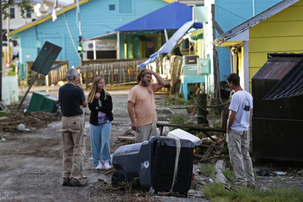 Residents survey the damages