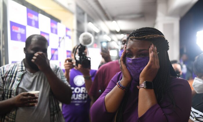 Democratic congressional candidate Cori Bush celebrates with friends and family at her campaign office in St. Louis, Mo., on Aug. 4, 2020. (Michael B. Thomas/Getty Images)