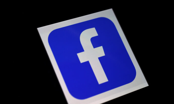 A Facebook App logo is displayed on a smartphone. (Olivier Douliery/AFP via Getty Images)