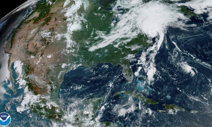 A satellite image shows Tropical Storm Isaias as it progresses over the northeast United States on Aug. 4, 2020.  (NOAA/Handout via Reuters)