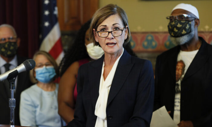 Iowa Gov. Kim Reynolds speaks after signing an executive order granting convicted felons the right to vote during a signing ceremony at the Statehouse in Des Moines, Iowa, on Aug. 5, 2020. (Charlie Neibergall/AP Photo)