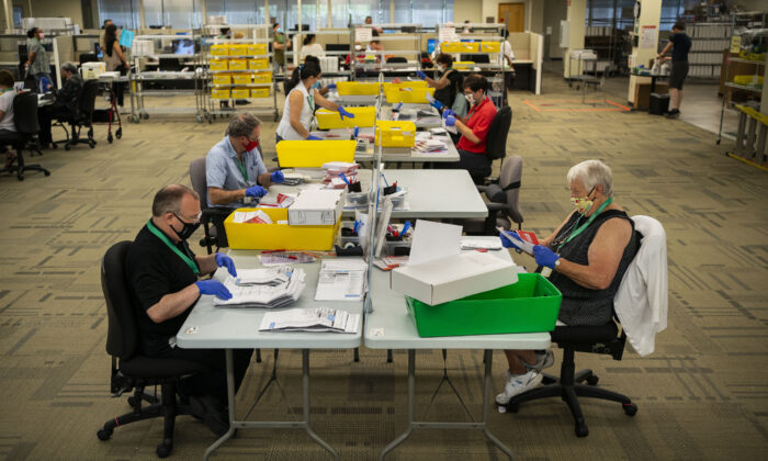 Mail-in ballots are processed for Washington's primary election by elections workers at the King County Elections headquarters in Renton, Washington, on August 4, 2020. (David Ryder/Getty Images)