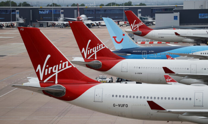 Virgin Atlantic and TUI Airways aircraft are seen at Manchester Airport in Manchester, Britain, June 8, 2020. (Phil Noble/Reuters)