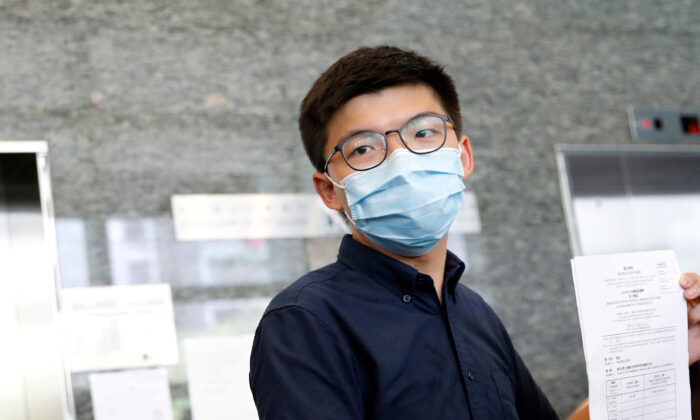 Pro-democracy activist Joshua Wong registers as a candidate for the upcoming Legislative Council election in Hong Kong, China, on July 20, 2020. (Tyrone Siu/Reuters)