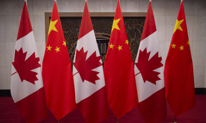 Canadian and Chinese flags taken prior to a meeting with Canada's Prime Minister Justin Trudeau and China's President Xi Jinping at the Diaoyutai State Guesthouse in Beijing, China, on Dec. 5, 2017. (Fred Dufour / POOL /AFP via Getty Images)