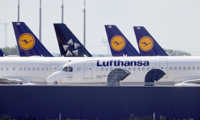 Airplanes of German carrier Lufthansa are parked at the Berlin Schoenefeld airport, amid the spread of the coronavirus disease (COVID-19) in Schoenefeld, Germany, on May 26, 2020. (Fabrizio Bensch/Reuters)
