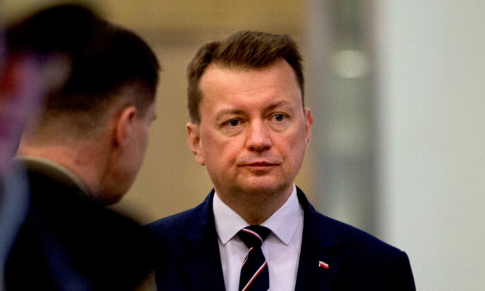 Polish Defence Minister Mariusz Blaszczak waits for the arrival of U.S. Secretary for Defence Mark Esper prior to a meeting at NATO headquarters in Brussels, Belgium, on Feb. 12, 2020. Virginia Mayo/Pool via Reuters)