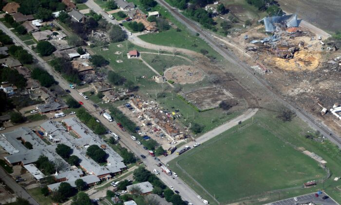 This aerial photo, shows the remains of a nursing home (L) apartment complex (C) and fertilizer plant (R) destroyed by an explosion at a fertilizer plant in West, Texas,  on April 18, 2013.   (Tony Gutierrez/ File/AP Photo)