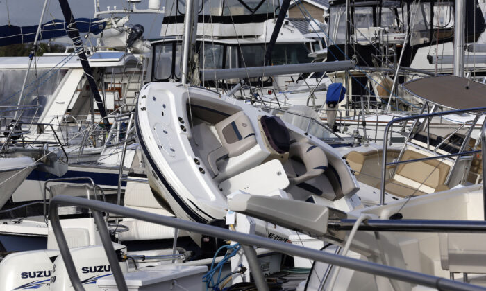 Boats are piled on each other at the Southport Marina following the effects of Hurricane Isaias in Southport, N.C., Aug. 4, 2020. (Gerry Broome/AP Photo)